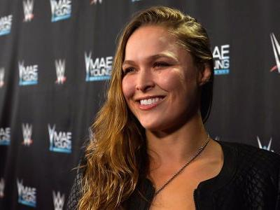 Former UFC champion Ronda Rousey signs with WWE after making a surprise appearance at Royal Rumble