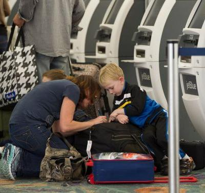 A viral Facebook post describes an 'extraordinary' moment at LAX when a group of women comforted a screaming toddler and his mother