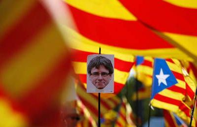 Puigdemont appears before Belgian authorities over extradition as Catalonia burns, general strike begins
