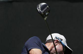 The Latest: Johnson's double bogey cuts into US Open lead