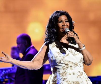 Aretha Franklin at home, surround by loved ones, family source says