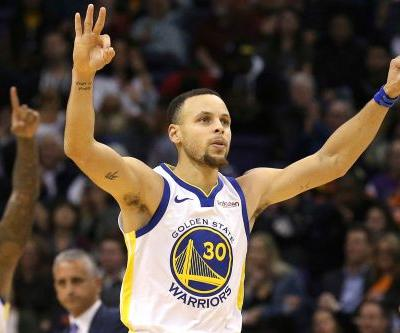 Warriors clip Suns as Stephen Curry explodes in fourth quarter