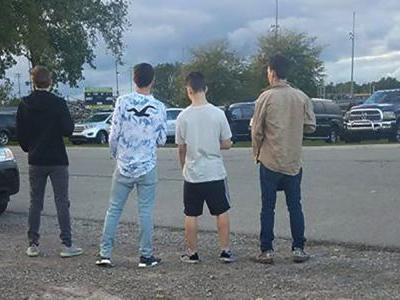 Photo showing teens stopping when they hear national anthem goes viral