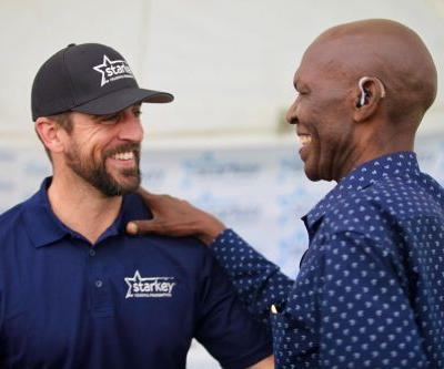 Aaron Rodgers, Danica Patrick visit Africa to help fit people with hearing aids