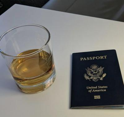I used my stockpile of credit card points to fly across the world in business class for under $100 - here's how I did it