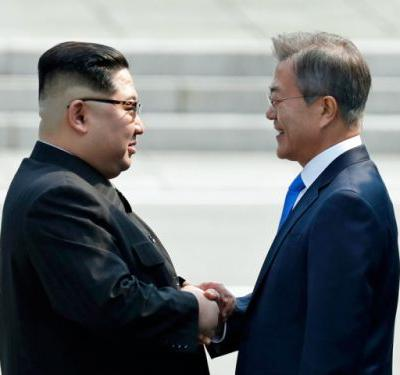 North Korea's Kim Jong Un steps over border and makes history in meeting with the South's Moon