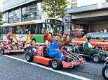 Tourists can tour Japanese cities in go-karts dressed like the characters from Mario Kart