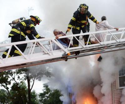 Images: Family rescued by ladder from raging fire