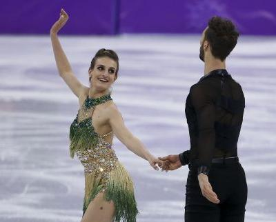 Wardrobe malfunction leaves French ice dancer exposed during Olympic performance