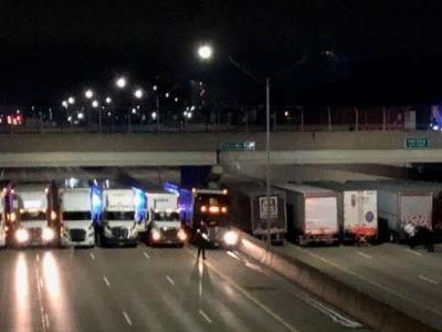 13 semis form line across freeway to help man considering suicide