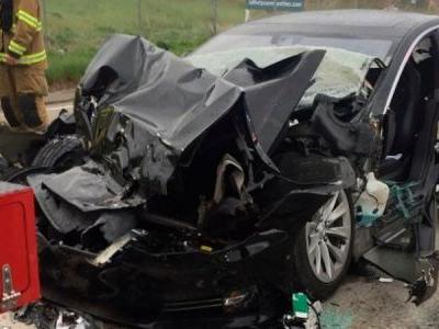 The feds are investigating a Tesla Model S that crashed while on Autopilot as the driver used her phone