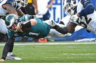 Eagles edge Rams as Wentz goes down with knee injury