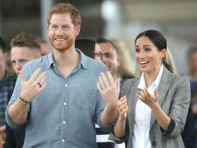 Meghan Markle And Prince Harry Have The Sweetest PDA Moment In The Rain - And Yes, It's As Romantic As It Sounds