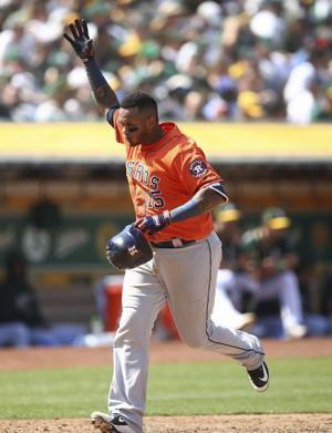 Verlander 200th W, Astros 5 HRs, top A's 9-4 to avoid sweep