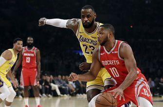 Fight in LeBron's home Lakers debut, 124-115 loss to Houston