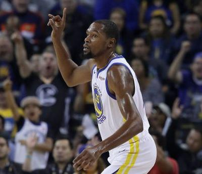 Stephen Curry, Kevin Durant lead Warriors past Suns 123-103