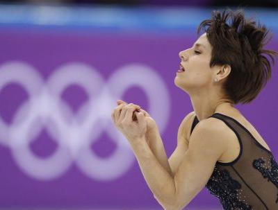 A Canadian Olympic gold medal-winning figure skater has rescued 2 dogs from being eaten in South Korea