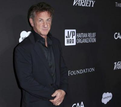 Sean Penn smokes cigarettes and says he's over acting in a bizarre 'Late Show' appearance