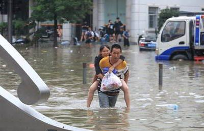 China's Henan province's emergency response level raised to second-highest as it's hit by heaviest rain in 1,000 years