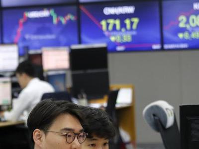 Asian shares mixed as China reports economy slowed in 2Q