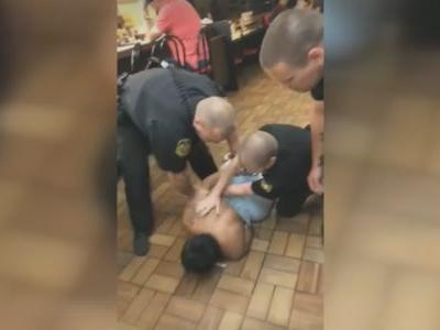 Outrage after video shows police throwing black woman to Waffle House floor