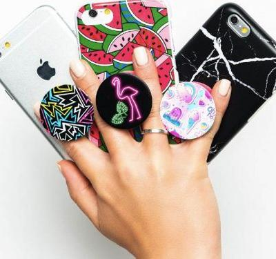 More than 40 million of these $10 expandable phone grips have been sold worldwide since their launch - and the newest style is a fidget spinner hybrid