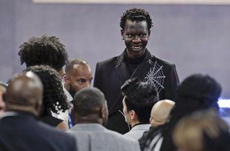 Miami stops Bol's slide in 2nd round, trades him to Denver