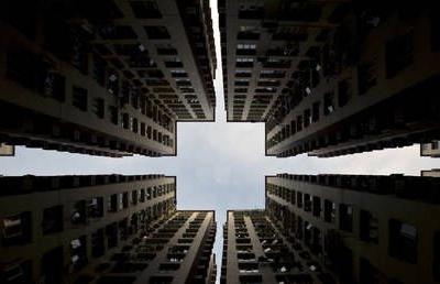 Is China trying to reset its entire housing market in response to the Evergrande crisis? Boom Bust investigates