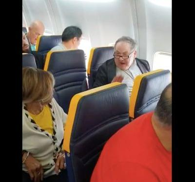 People are threatening to boycott Ryanair after the airline failed to remove a white man who shouted racist insults at an elderly black woman on one of its flights