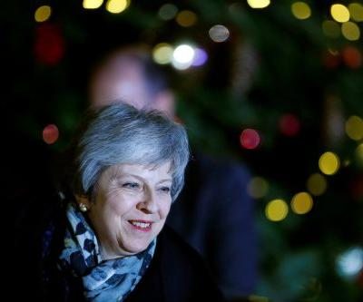 British PM Theresa May survives no-confidence vote amid Brexit chaos
