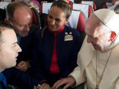 Pope Francis marries off two flight attendants on a plane for the first time