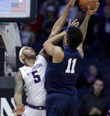 Law scores 18 to lead Northwestern 70-61 over Penn State