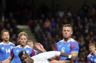 Late Mbappe double earns France draw against Iceland