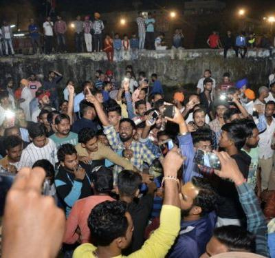Speeding train runs over crowd watching fireworks in India, killing at least 50 people