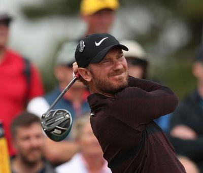 The Latest: Woods shoots 66, in contention at British Open