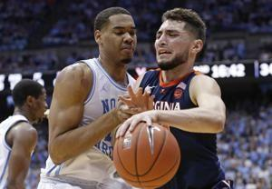 Guy's big shots finish No. 4 Virginia's rally over No. 8 UNC