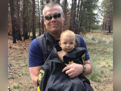 Police: Missing baby found naked, face down in woods after being abandoned by father