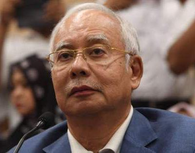 Malaysian Police Seize 70 Suitcases of Cash and 280 Luxury Bags in Probe of Former Prime Minister