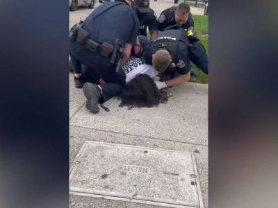 LMPD officer facing investigation after video surfaces of him striking man in face during arrest