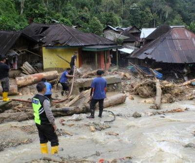 Floods and landslides in Indonesia leave 22 dead