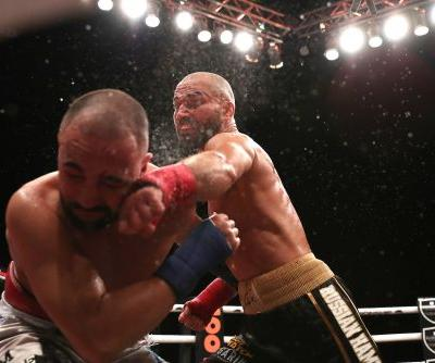 Paulie Malignaggi, booed and cut multiple times, complains in the middle of the ring after losing to Artem Lobov in his bareknuckle debut