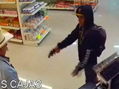 Man in cowboy hat darts after man with gun, helps stop robbery attempt, business says