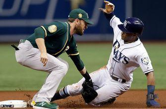 Khris Davis knocks home run No. 42 in extra-innings as A's edge Rays 2-1