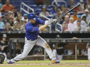 Holaday's pinch-single in 11th lifts Marlins over Mets 4-3
