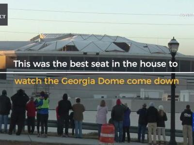 Bus perfectly ruins view of Georgia Dome implosion