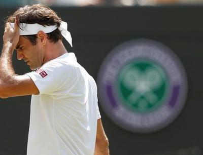 Anderson stuns Federer in quarter-final cliffhanger