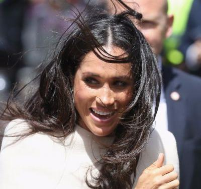 Meghan Markle wore a $5,000 flowing maxi dress - and some people are saying it's 'too big' for her
