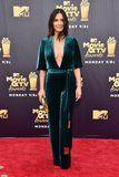 Olivia Munn Wore a Sexy Green Jumpsuit to the MTV Awards, and It Plunges Real Looooooow
