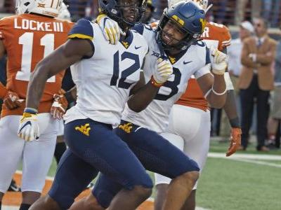 Saturday's top 25: West Virginia scores late to tame Texas, 42-41