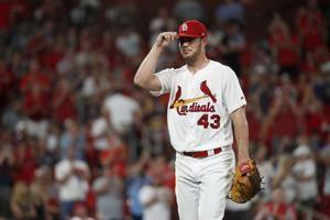 Hudson, Cards take no-hit bid into 8th and blank Brewers 3-0